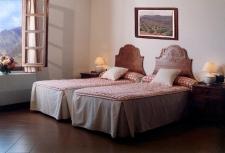 Slaapkamer in een van de huisjes